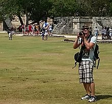 Tourist_taking_photographs_and_video_at_archaelogical_site